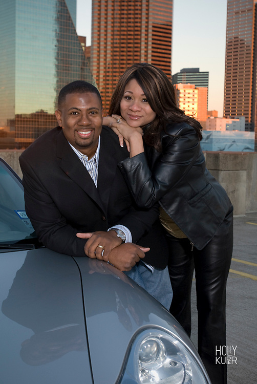 Black Couple with their Car in Dallas