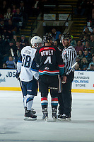 KELOWNA, CANADA - DECEMBER 3: Linesman Bevan Mills discusses penalty calls with Madison Bowey #4 of Kelowna Rockets and Brett Stovin #38 of Saskatoon Blades on December 3, 2014 at Prospera Place in Kelowna, British Columbia, Canada.  (Photo by Marissa Baecker/Shoot the Breeze)  *** Local Caption *** Bevan Mills; Madison Bowey; Brett Stovin;