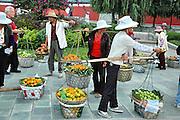 China, Yunnan, Dali City, mango sellers
