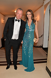 ELIZABETH HURLEY and DAVID YARROW at the Tusk Friends Dinner in aid of wildlife charity Tusk held at Claridge's, Brook Street, London on 11th March 2014.
