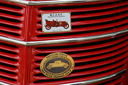 04 August 2012:  McLean County Antique Auto Club and State Farm Insurance radiator grill badging on an 1938 International D2 1/2 ton pickup truck shown at the McLean County Antique Automobile Club Show at the David Davis Mansion, Bloomington IL