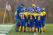 Salisbury Mills, New York  - Two Washingtonville coaches talks to their team in a huddle during an Orange County Youth Football League Division I playoff game at Lasser Field on Sunday, Nov. 3, 2013.