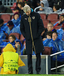 Arsenal manager Arsene Wenger looks dejected - Mandatory byline: Matt McNulty/JMP - 16/03/2016 - FOOTBALL - Nou Camp - Barcelona,  - FC Barcelona v Arsenal - Champions League - Round of 16