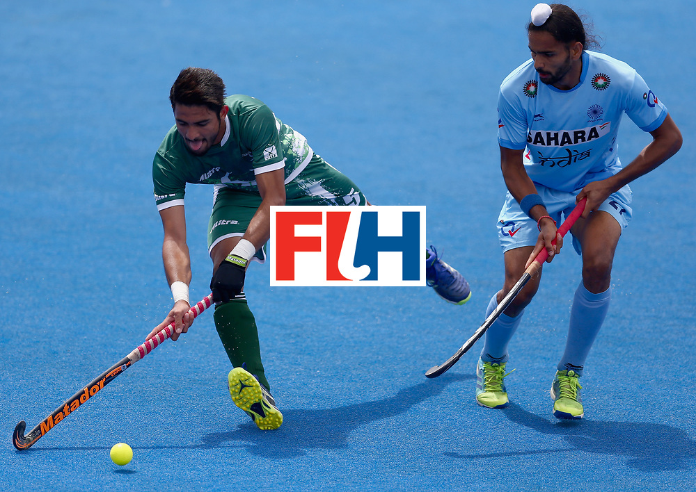 LONDON, ENGLAND - JUNE 24:  Abu Mahmood of Pakistan and Akashdeep Singh of India battle for possession during the 5th-8th place match between Pakistan and India on day eight of the Hero Hockey World League Semi-Final at Lee Valley Hockey and Tennis Centre on June 24, 2017 in London, England.  (Photo by Steve Bardens/Getty Images)