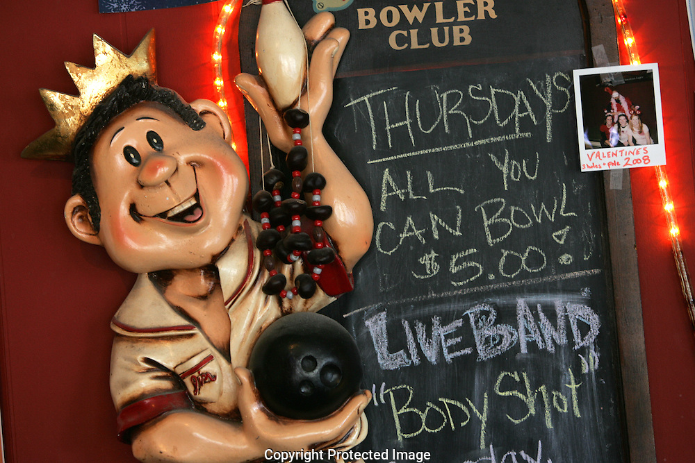 A sign inside the door announces specials and upcoming bands at Grove City Lanes.(Jodi Miller/Aive)