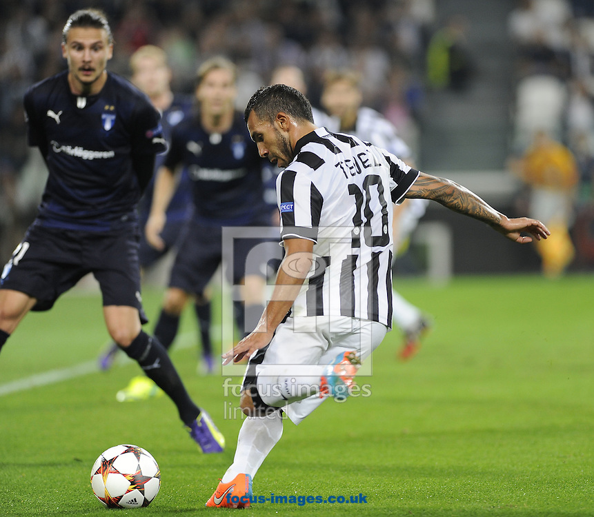Carlos Tevez of Juventus during the UEFA Champions League match at Juventus Stadium, Turin<br /> Picture by Stefano Gnech/Focus Images Ltd +39 333 1641678<br /> 16/09/2014