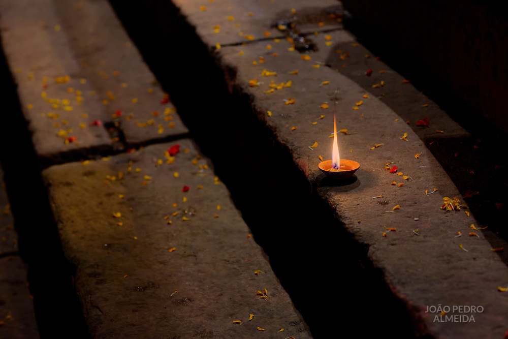 Diya (oil lamp) burning at the steps of the Main ghat