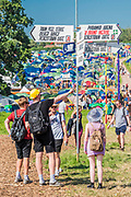 Arrivals get their bearings and look for places to camp  -The 2019 Glastonbury Festival, Worthy Farm. Glastonbury, 26 June 2019