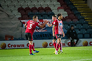Harry Toffolo of Lincoln City celebrates team mate Tyler Walker of Lincoln City's goal to make the score 1-1 on the 86th minute during the EFL Sky Bet League 1 match between Rochdale and Lincoln City at the Crown Oil Arena, Rochdale, England on 17 September 2019.