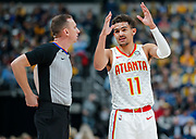 INDIANAPOLIS, IN - DECEMBER 31: NBA referee Justin Van Duyne #64 talks with Trae Young #11 of the Atlanta Hawks during the game against the Indiana Pacers at Bankers Life Fieldhouse on December 31, 2018 in Indianapolis, Indiana. NOTE TO USER: User expressly acknowledges and agrees that, by downloading and or using this photograph, User is consenting to the terms and conditions of the Getty Images License Agreement. (Photo by Michael Hickey/Getty Images) *** Local Caption *** Justin Van Duyne