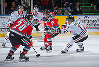 KELOWNA, CANADA - OCTOBER 4:  Adam Rossignol #17 of the Portland Winterhawks tries to block a shot by Tyson Baillie #24 of the Kelowna Rockets while being checked by Rourke Chartier #14 of the Kelowna Rockets at the Kelowna Rockets on October 4, 2013 at Prospera Place in Kelowna, British Columbia, Canada (Photo by Marissa Baecker/Shoot the Breeze) *** Local Caption ***