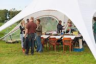 Nederland, Den Bosch, 20140830 <br /> Kunstzinnige workshops in de piramide tent. Met oa. Evalore Beukers.<br /> Effect Festival - 30 Augustus 2014, De Gemeint 3, bij het Engelermeer tussen Vlijmen en Den Bosch.<br /> eFFect is een manifestatie van lokale duurzame initiatieven die burgers samen van onderop in het leven zetten. Een marktplaats, maar ook workshops door kunstenaars en muziek optredens. Daarnaast ook veel gezonde en alternatieve eettentjes.<br /> <br /> Netherlands, Den Bosch, 20140830.