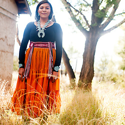 Kayla Begay at her family's old home in Navajo, N.M.
