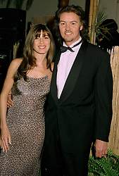 MR & MRS PAUL YOUNG, he is the pop singer, at a ball in London on 22nd May 1997.LYO 44