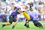 FORT WORTH, TX - SEPTEMBER 13:  Mitch Leidner #7 of the Minnesota Golden Gophers is brought down by Mike Tuaua #93 and Ranthony Texada #11 of the TCU Horned Frogs on September 13, 2014 at Amon G. Carter Stadium in Fort Worth, Texas.  (Photo by Cooper Neill/Getty Images) *** Local Caption *** Mitch Leidner; Mike Tuaua; Ranthony Texada