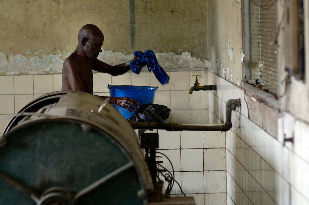 Kinshasa November 30, 2005 -  Kinshasa General Hospital, a man in the washery  The Kinshasa General Hospital, is far from being a bush dispensary. With its 2,000 beds and its 2,250 employees (doctors, nurses and administrative personnel), it is one of Africa's most impressive medical facilities. It offers a full range of services and is the undisputed referral centre for the Congolese capital. Its patients the sick, accident victims and war casualties, both civilian and military  have one thing in common: their suffering, which the staff do their best to alleviate with the means available. But those means are often woefully inadequate