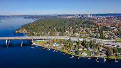 United States, Washington, Bellevue.  Lake Washington and SR520 floating bridge in autumn, with dowtown Bellevue in distance (aerial view)