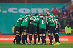 STOKE-ON-TRENT, ENGLAND - Sunday, January 4, 2015: Wrexham players form a team huddle before the FA Cup 3rd Round match against Stoke City at the Britannia Stadium. (Pic by David Rawcliffe/Propaganda)
