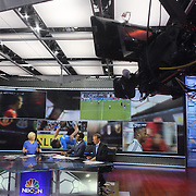 NBC Sports Network presenters Rebecca Lowe, Robbie Earle, and Robbie Mustoe, (right), at work in the NBC Sports Network studios in Stamford, Connecticut, during Saturday morning live broadcasts of English Premier League games. Stamford,  Connecticut, USA. 21st September 2013. Photo Tim Clayton
