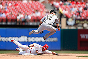 ST. LOUIS, MO - JUNE 30: Clint Barmes #12 of the Pittsburgh Pirates turns a double play against Skip Schumaker #55 of the St. Louis Cardinals at Busch Stadium on June 30, 2012 in St. Louis, Missouri. The Pirates won 7-3 as temperatures reached 103 degrees during the game. (Photo by Joe Robbins)
