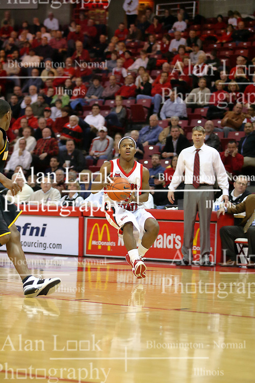 """18 January 2007: Keith """"Boo"""" Richardson, watched by Porter Moser. The Shockers of Wichita State were shut off by the Redbirds by a score of 83-75 at Redbird Arena in Normal Illinois on the campus of Illinois State University."""