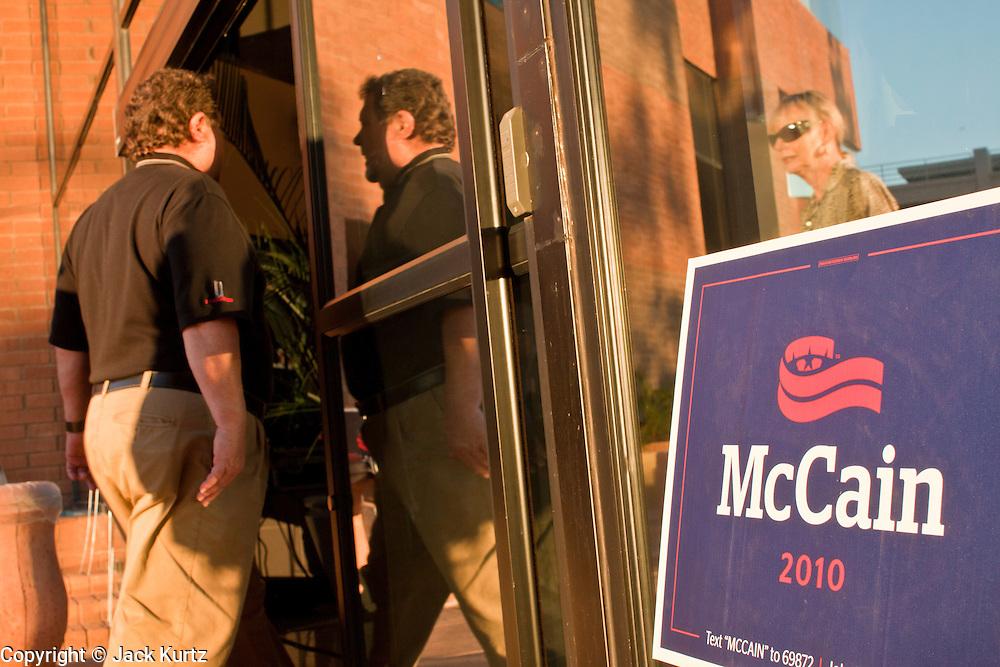 Aug. 23, PHOENIX, AZ: People walk into the Phoenix, AZ, campaign offices of Sen. John McCain. US Sen. John McCain held the final of his primary election campaign at his campaign offices in Phoenix Monday. McCain, Arizona's senior Republican US Senator, is facing former Congressman JD Hayworth in the primary, Tuesday, Aug. 24. McCain has outspent Hayworth by a considerable margin and is expected to win.   Photo by Jack Kurtz