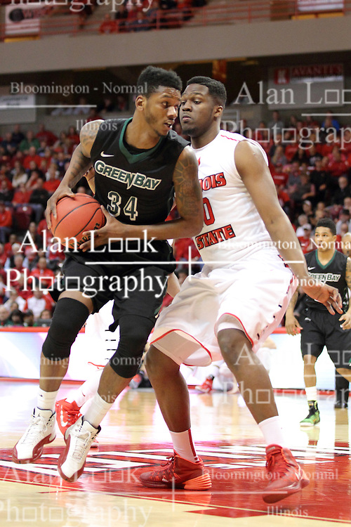 18 March 2015:  Alfonzo McKinnie navigates around John Jones  during an NIT men's basketball game between the Green Bay Phoenix and the Illinois State Redbirds at Redbird Arena in Normal Illinois