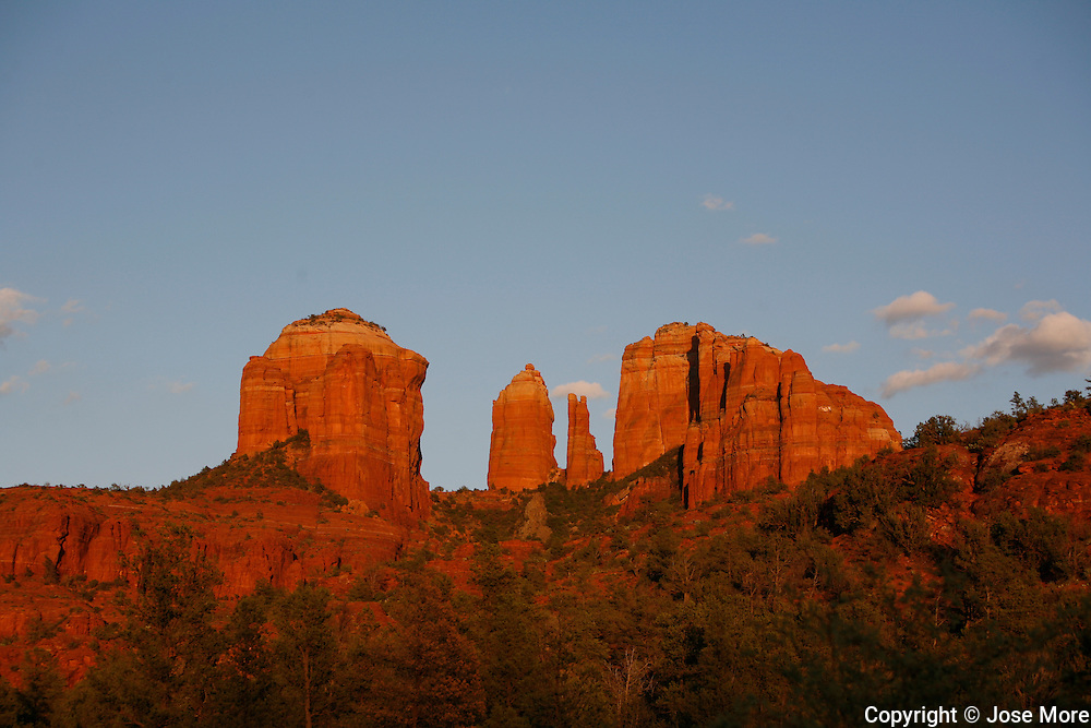 Cathedral Rock is a famous landmark on the Sedona, skyline. It is located in the Coconino National Forest in Yavapai County. Sedona straddles the county line between Coconino and Yavapai counties in the northern Verde Valley, Arizona. Sedona's main attraction is its array of red sandstone formations that appear to glow in brilliant orange and red when illuminated by the rising or setting sun. It was named after Sedona Arabella Miller Schnebly (1877&ndash;1950)<br /> Photography by Jose More
