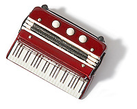 toy accordion red and white cut out photographed on a white background