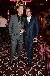 Left to right, JULIAN CLARY and PERCY GIBSON at a party to celebrate the publication of 'Passion for Life' by Joan Collins held at No41 The Westbury Hotel, Mayfair, London on21st October 2013.