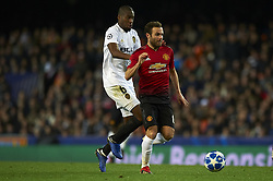 December 12, 2018 - Valencia, Spain - Geoffrey Kondogbia of Valencia and Juan Mata of Manchester United during the match between Valencia CF and Manchester United at Mestalla Stadium in Valencia, Spain on December 12, 2018. (Credit Image: © Jose Breton/NurPhoto via ZUMA Press)