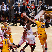 31 January 2017:  The San Diego State Aztecs men's basketball team hosts Wyoming Tuesday night at Viejas Arena. San Diego State guard Montaque Gill-Caesar (23) goes up for a shot and is fouled by Wyoming forward Hayden Dalton (20) in the first half. The Aztecs lead the Cowboys 31-27 at half time. www.sdsuaztecphotos.com