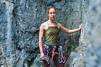 Portrait of a late 20's woman ready to strt a rock climb...Model Release: 20070608_MR_A