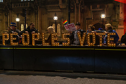 """A """"Peoples Vote"""" illuminated sign,  associated with a second referendum, outside the Houses of Parliament in London as MPs debate Prime Minister Theresa May's Brexit deal. London, January 15 2019."""