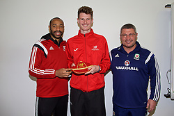 NEWPORT, WALES - Sunday, May 31, 2015: Welsh Colleges' players presented with a cap by Thierry Henry and Osian Roberts during the Football Association of Wales' National Coaches Conference 2015 at Dragon Park FAW National Development Centre. (Pic by David Rawcliffe/Propaganda)