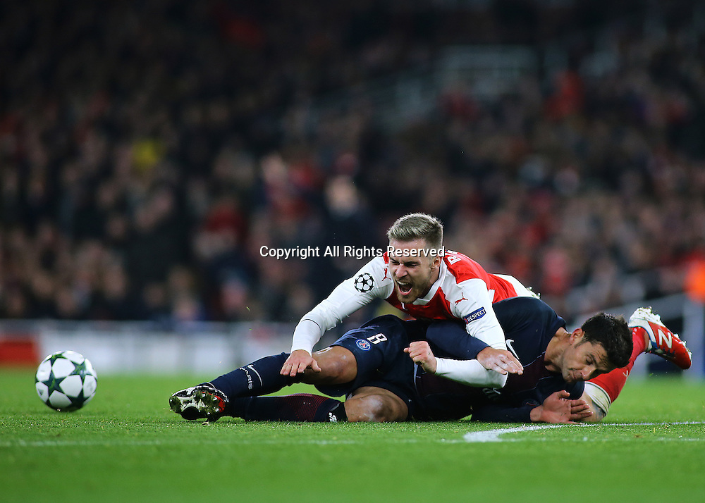23.11.2016. Emirates Stadium, London, England. UEFA Champions League Football. Arsenal versus Paris Saint Germain. Arsenal Midfielder Aaron Ramsey is brought down in the PSG area by Paris Saint-Germain Midfielder Thiago Motta, but is denied a spot kick.