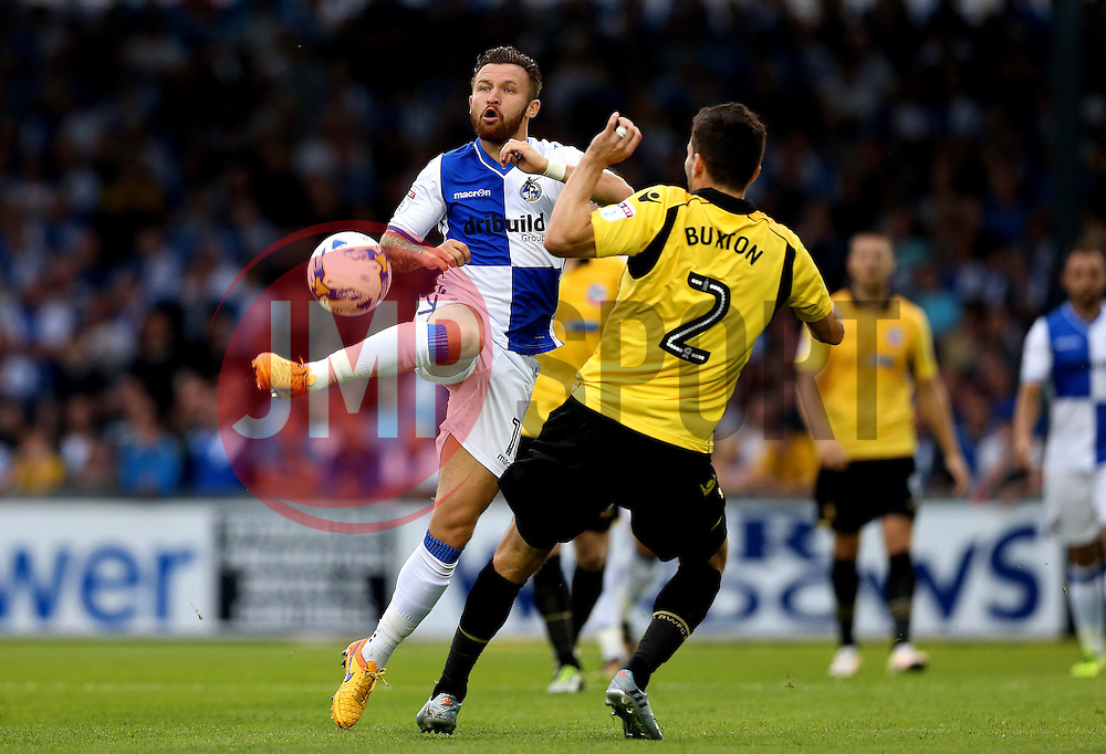 Matt Taylor of Bristol Rovers controls the ball under pressure from Lewis Buxton of Bolton Wanderers - Mandatory by-line: Robbie Stephenson/JMP - 17/08/2016 - FOOTBALL - Memorial Stadium - Bristol, England - Bristol Rovers v Bolton Wanderers - Sky Bet League One