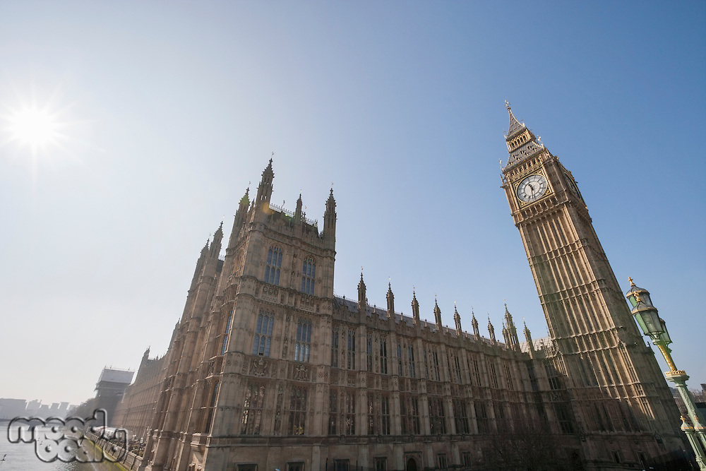 Low angle view of Big Ben and parliament building against clear sky at London; England; UK
