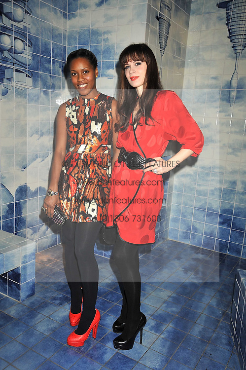 Left to right, SUSAN BENDER and LARA BOHINC at the Prada Congo Art Party hosted by Miuccia Prada and Larry Gagosian at The Double Club, 7 Torrens Street, London EC1 on 10th February 2009.