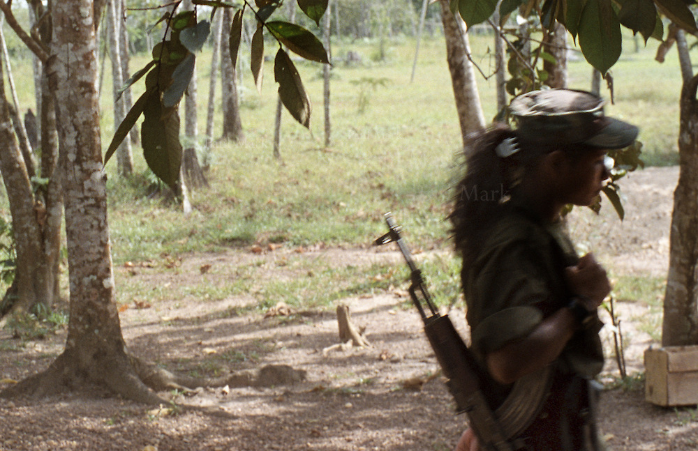 Woman guerrilla with an AK-47 weapon.