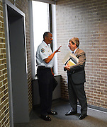 Gary Cosby Jr./Decatur Daily   Decatur Fire and Rescue division chief Lorenzo Jackson and Decatur mayor Don Kyle have a talk beside the elevators in City Hall following a work session.