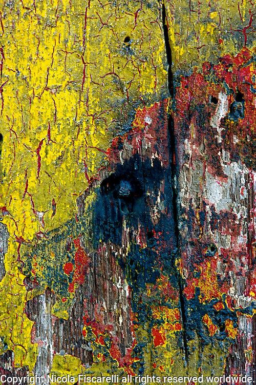 A closeup of an old painted wooden suport beam in an abandoned Roebling manufacturing building in Trenton New Jersey,
