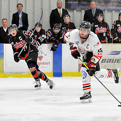 """FORT FRANCES, ON - May 2, 2015 : Central Canadian Junior """"A"""" Championship, game action between the Fort Frances Lakers and the Soo Thunderbirds, Championship game of the Dudley Hewitt Cup. Anthony Miller #15 of the Soo Thunderbirds shoots the puck during the first period.<br /> (Photo by Shawn Muir / OJHL Images)"""