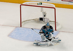 May 18, 2010; San Jose, CA, USA; San Jose Sharks goaltender Evgeni Nabokov (20) makes a save during the second period of game two of the western conference finals of the 2010 Stanley Cup Playoffs against the Chicago Blackhawks at HP Pavilion.  The Blackhawks defeated the Sharks 4-2. Mandatory Credit: Jason O. Watson / US PRESSWIRE