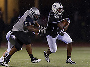 Cedar Ridge running back, Daniel Williams gets pursued by Hendrickson's Coby Fontenette Friday night at Dragon Stadium. The Raiders lost to the Hawks 35-28.