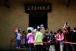 Visitors queue to enter the former residence of Mao Zedong in Shaoshan, Hunan Province in central China, 28 April 2016. Shaoshan is the hometown of former Communist leader Mao Zedong, popularly known as Chairman Mao. Thousands of visitors descend on this small Chinese town burrowed in the hills of Central China's Hunan province to pay homage to the great helmsman everyday. It is one of the core sites of the 'Red Tourism' industry, where communist party cadres and ordinary Chinese tourists alike seek to relive the experiences and rekindle the spirit of the revolutionaries.