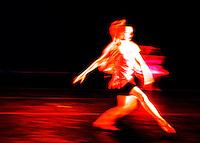 2 dancers, merging.