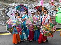&copy; Licensed to London News Pictures. 14/05/2017. LONDON, UK. <br /> Performers stop to pose for a photograph as they dance in the street during the Boishakhi Mela street parade festival along and around Brick Lane in east London to celebrate the Bengali New Year. The Boishakhi Mela in Tower Hamlets is the largest celebration of Bengali New Year in Europe, attracting performers and crowds of thousands of spectators from around the world. Photo credit: Vickie Flores/LNP