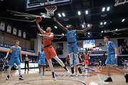 Cal State Fullerton Titans forward Johnny Wang (33) scores on a reverse layup against San Diego Toreros forward James Jean-Marie (23) during an NCAA basketball game, Wednesday, Dec. 11, 2019, in Fullerton, Calif. San Diego defeated CSUF 66-54. (Jon Endow/Image of Sport)