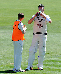 Surrey's Kevin Pietersen receives a drink from the 12th man. - Photo mandatory by-line: Harry Trump/JMP - Mobile: 07966 386802 - 22/04/15 - SPORT - CRICKET - LVCC County Championship - Division 2 - Day 4 - Glamorgan v Surrey - Swalec Stadium, Cardiff, Wales.